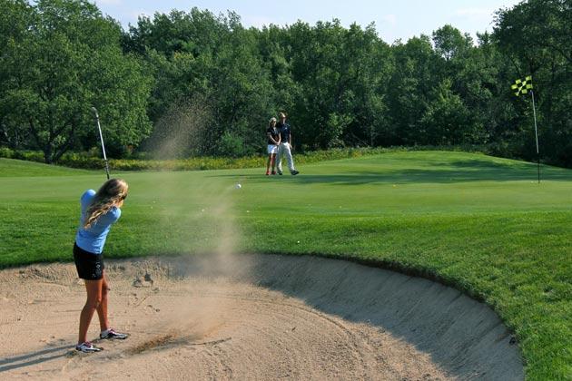 Playing golf at Boyne Highlands Resort. Photo courtesy of Boyne Highlands Resort.